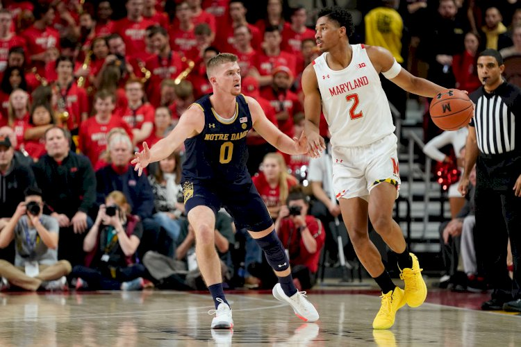 Maryland guard Aaron Wiggins follow slams his own missed 3-point shot